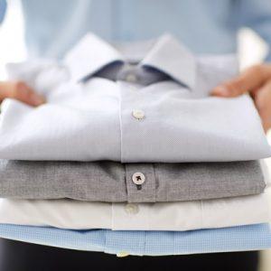 close-up-of-businessman-holding-shirts-PPSBH4Q